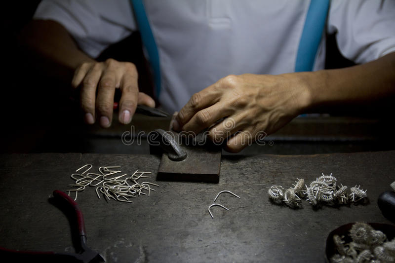 Making of silver rings. royalty free stock image