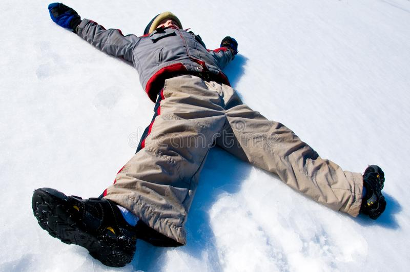 Making a snow angel royalty free stock photos