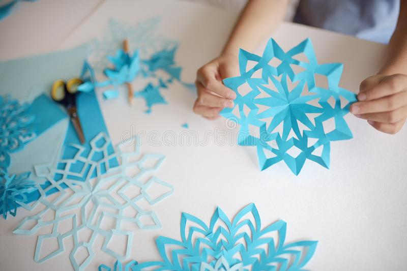 Making of snowflakes from paper. royalty free stock photo