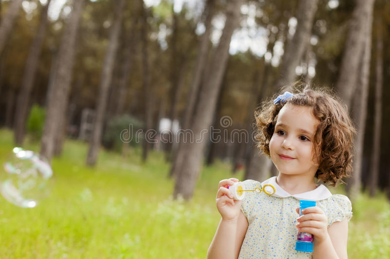 Download Making soap bubbles. stock photo. Image of expression - 29379050