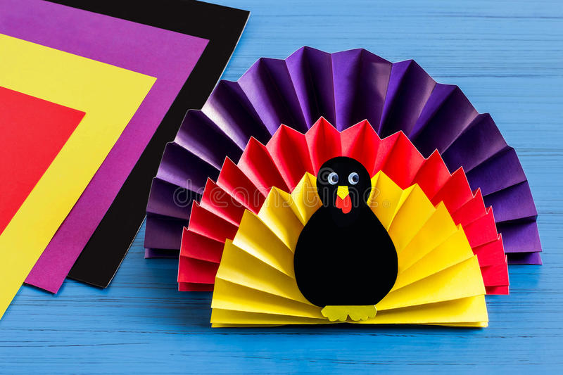 Making souvenir by Thanksgiving: turkey made of paper. Step 9. Making souvenir for Thanksgiving: turkey made of paper. Original children`s art project. DIY royalty free stock photography