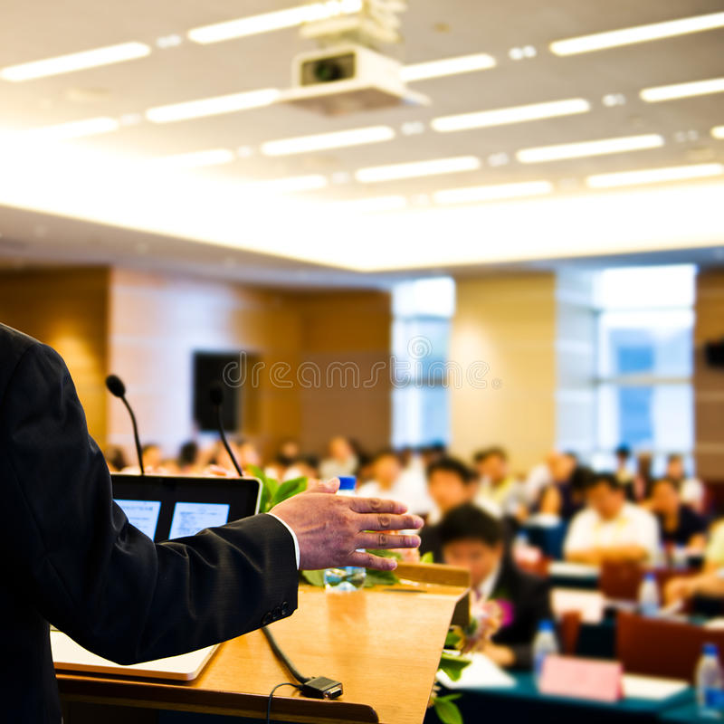 Making speech. Business man making speech at a conference hall royalty free stock image