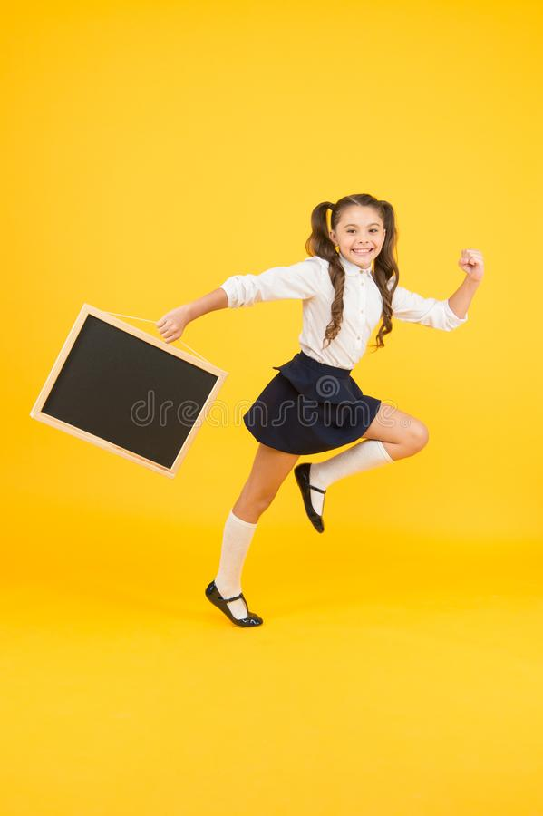 Making step. Schoolgirl pupil informing. School girl hold blank chalkboard copy space. Follow me. Announcement and royalty free stock image