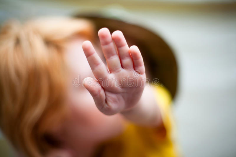 Making stop sign. Closeup of child hand making stop sign royalty free stock image