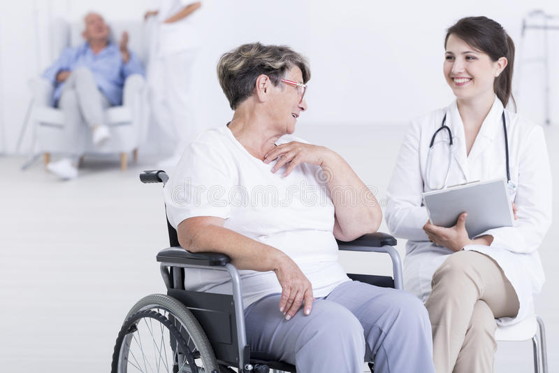 Making sure her patients are happy stock photo