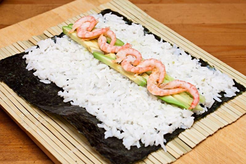 Making sushi rolls. royalty free stock images