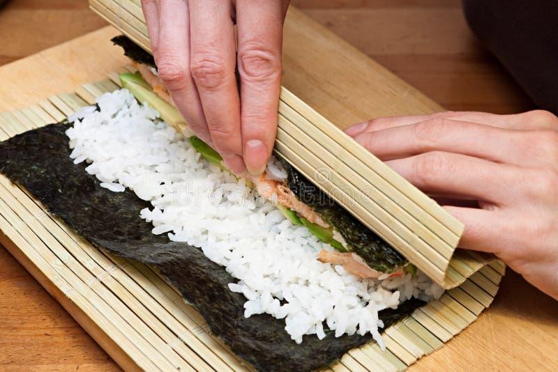 Making sushi rolls. royalty free stock photography