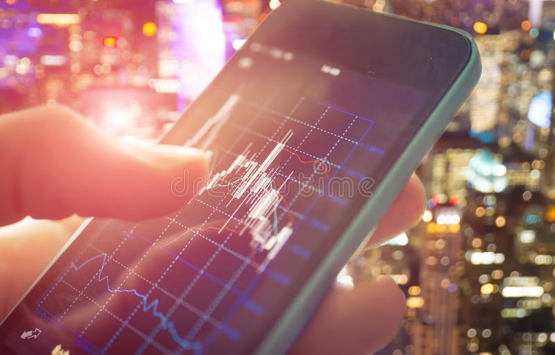 Making trading online on the smart phone stock photos