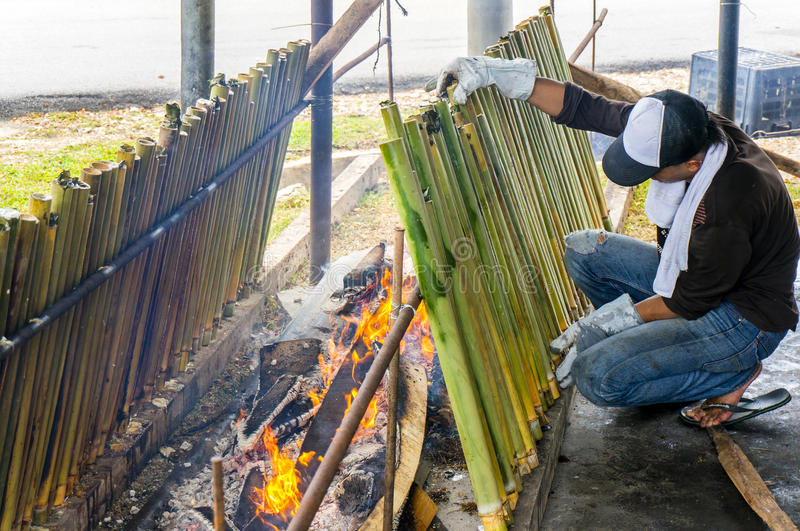 The making of traditional Malay food,. PAHANG, M'SIA-JULY 27: Unidentified Malaysian traditional food seller was cooking lemang at Kuantan town on July 27, 2014 stock image