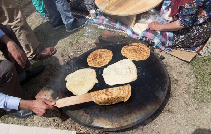 Making of traditional turkish gozleme pancake stock images