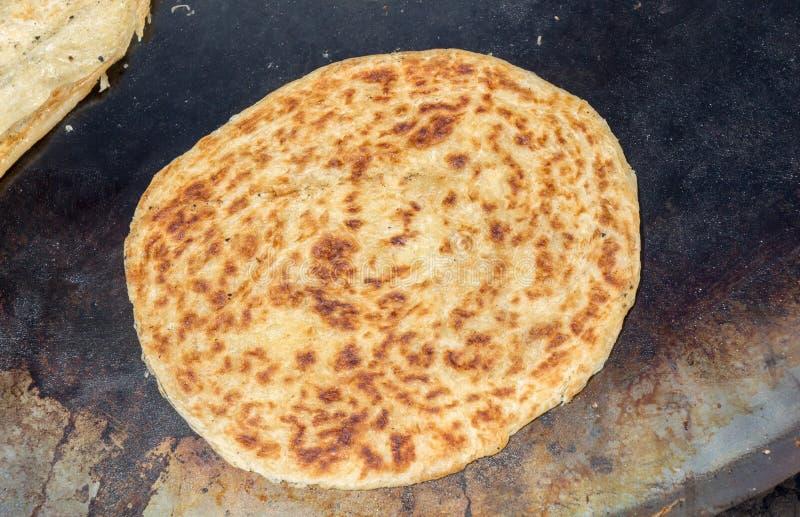 Making of traditional turkish gozleme pancake royalty free stock image