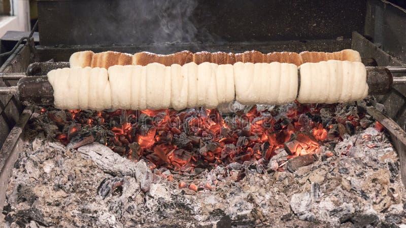 Making Trdlo, original Czech cuisine. royalty free stock photography