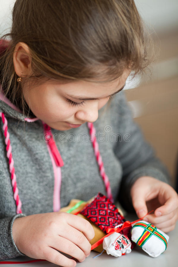 Making Ukrainian national doll (motanka) stock photography