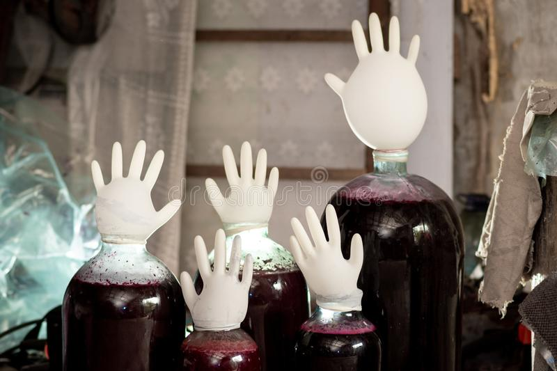 Making wine with large cans and gloves. Fermentation of wine with large cans and gloves stock photography