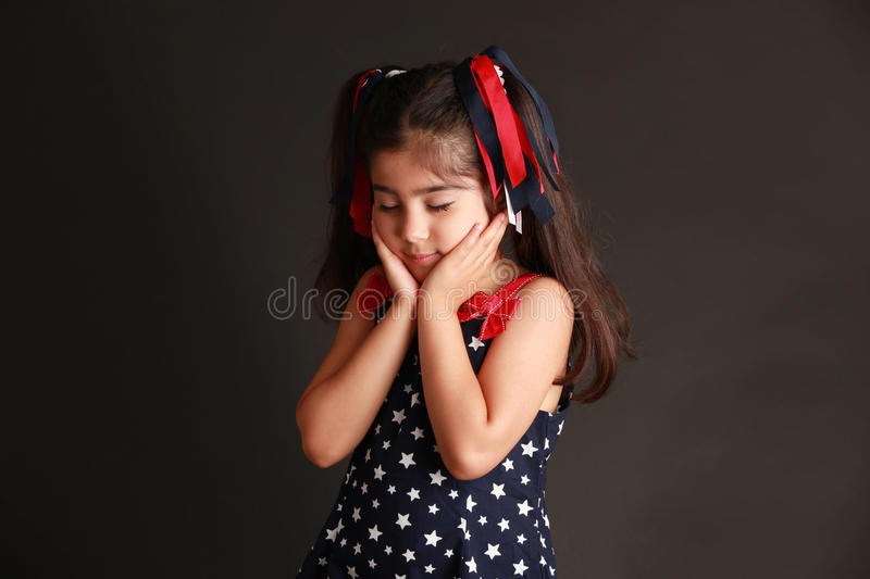 Making a wish. Little girl making a wish stock photography