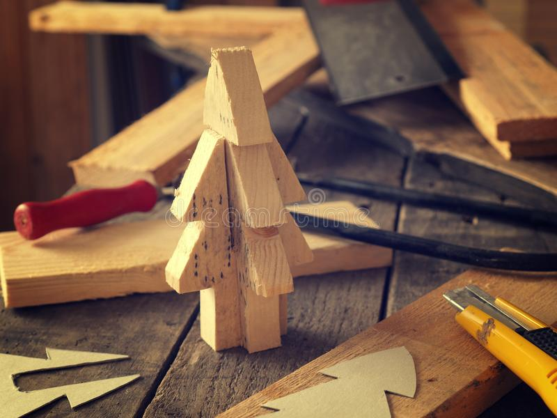 Making a wooden Christmas tree stock images