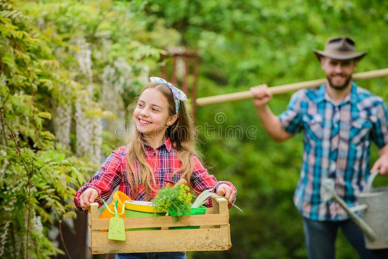 Making your life bright and colored. ecology. Gardening tools. father and daughter on ranch. spring village country stock photography