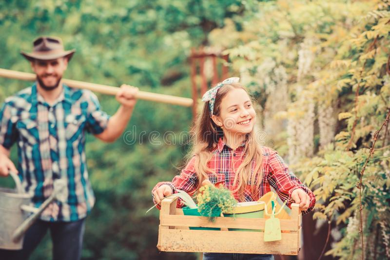Making your life bright and colored. ecology. Gardening tools. father and daughter on ranch. spring village country royalty free stock photo