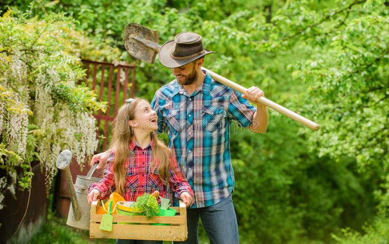 Making your life colored. family farm. father and daughter on ranch. little girl and happy man dad. earth day. spring. Making your life colored. family farm stock image
