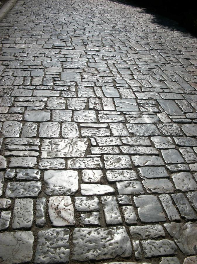 The shiny sloping floor from the Acropolis Athens. On making your way down you may encounter this sloping floor. I loved it the shiny stone where thousands of royalty free stock image