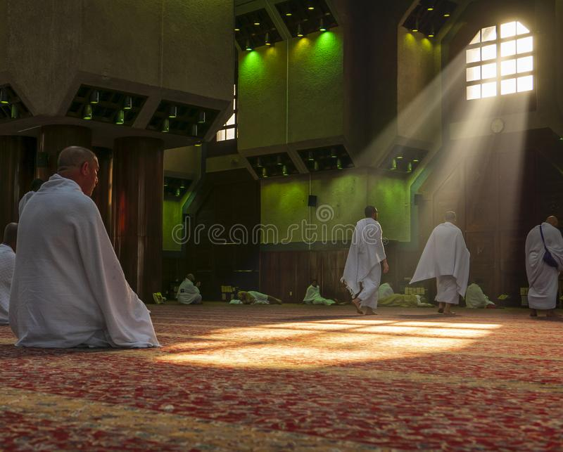 MAKKAH, SAUDI ARABIA - CIRCA DEC 2016 : Muslim pilgrims in `ihram` clothes pray at Tanaeem mosque, 7 km away from Mecca. `Ihram. ` clothes consist of two royalty free stock photos