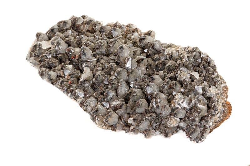 Makro av en sten Ilvaite som är mineralisk på en vit bakgrund royaltyfri bild
