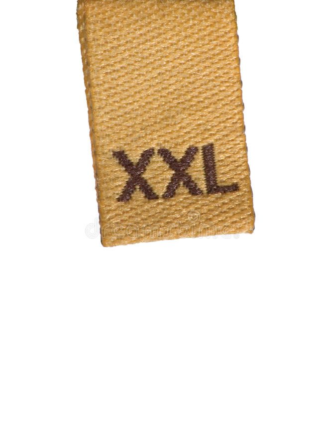 Makro des XXL Größen-Kleidungskennsatzes auf Weiß lizenzfreie stockbilder
