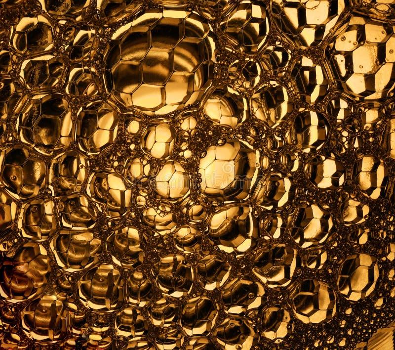 Makro goldene Bienenwaben stockfotografie
