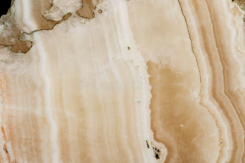 Makro- kamienny kopalina marmuru onyks na czarnym tle obrazy stock