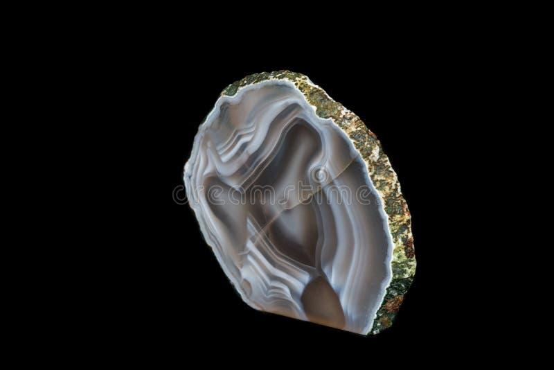 Makro- kamienny kopalny agat na czarnym tle zdjęcia royalty free
