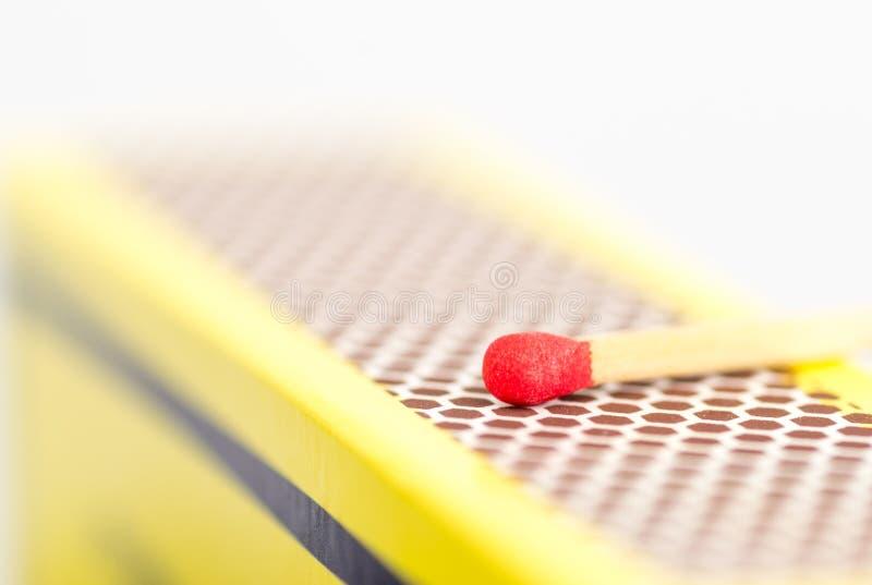 Makro nah oben von einem roten Matchkopf lizenzfreie stockbilder