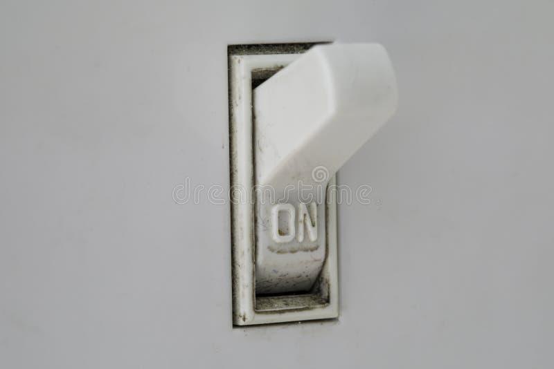 Makro som är smutsig på den ljusa strömbrytaren fotografering för bildbyråer