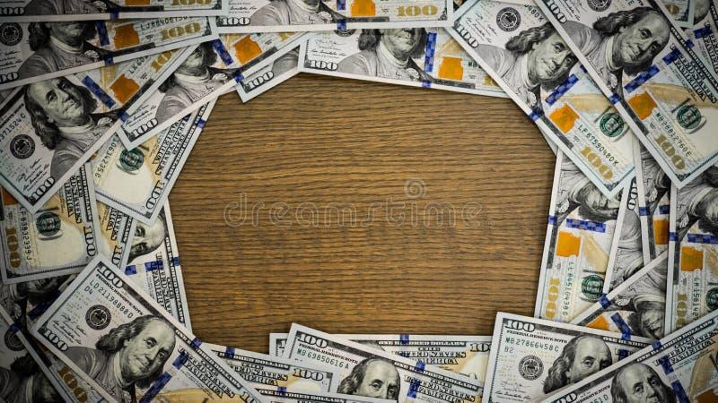 Makro som skjutas av en 100 dollar Dollar Closeupbegrepp Amerikanska dollar kassapengar _ Bakgrund av de hundra dollarräkningarna arkivbild