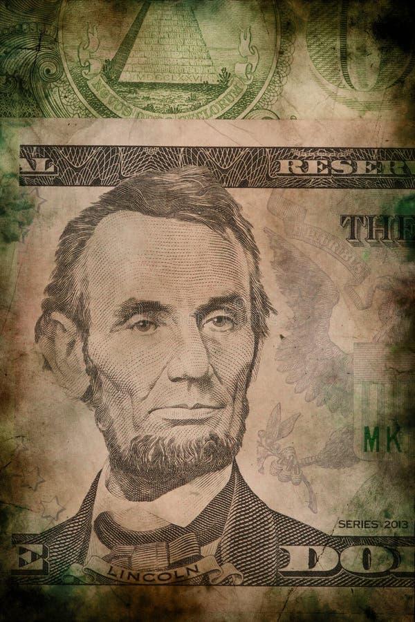 Makro von Abraham Lincoln auf fünf USA-Dollarbanknotenschmutz-Weinleseart stockbild