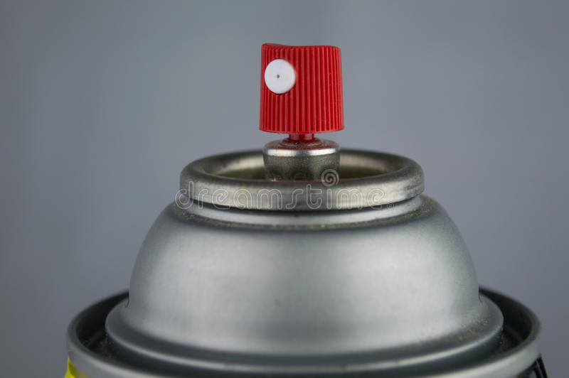 Makro- zbliżenie czerwony i biały nozzle na górze srebra może o zdjęcia royalty free