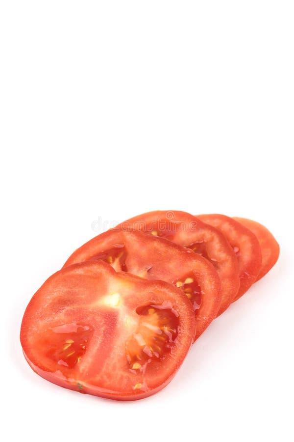 Makro- zbliżenie pokrajać pomidor nad białą tło kopii przestrzenią obrazy stock