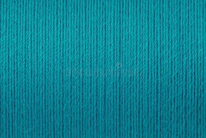 Makrobild av bakgrund för turkostrådtextur royaltyfria bilder