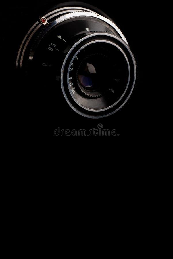 Makrobild des Objektivs auf Retro- Kamera stockfoto