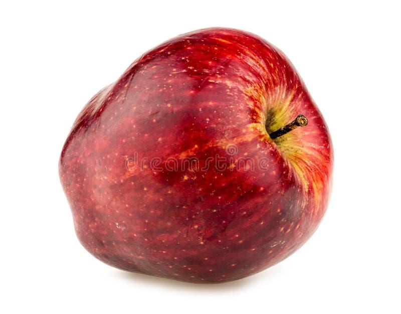 Makrocloseup av det fylliga röda äpplet arkivfoto
