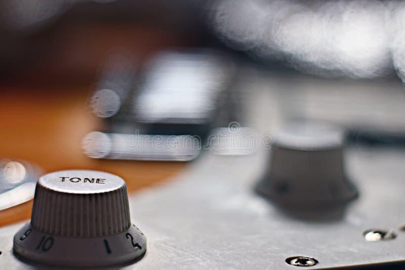 Makrogitarrenmusikinstrumentrock stockfotografie