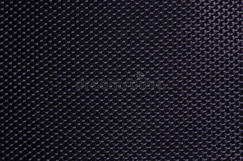 Makrotaschenrucksack des schwarzen dichten Gewebes lizenzfreie stockbilder
