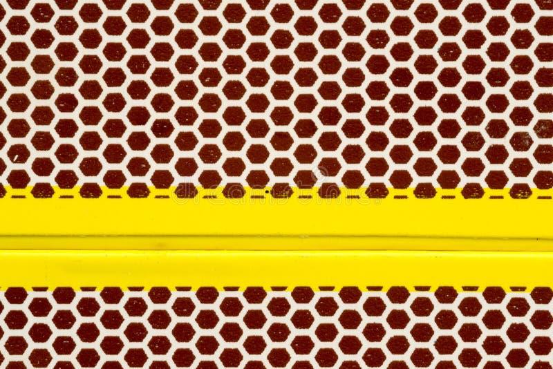 Makrozusammenfassung einer Streichholzschachtelstreikoberfläche stockfotografie