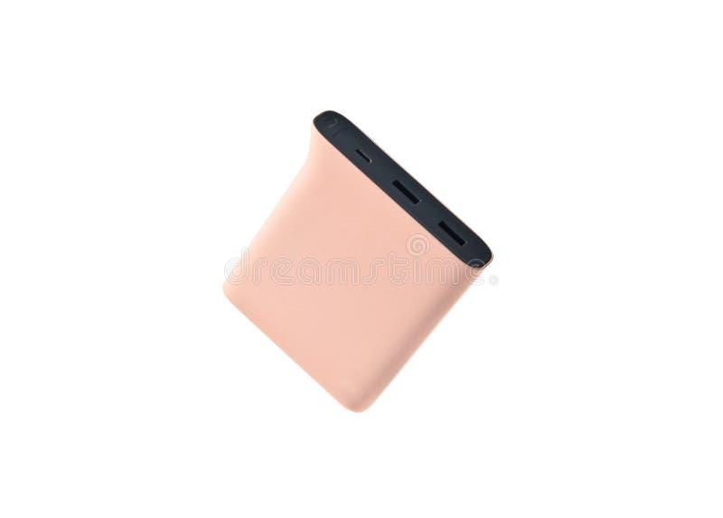 Maktbank för pastellfärgade rosa färger som isoleras på vit bakgrund Yttre batteri för smartphones och andra grejer arkivbilder