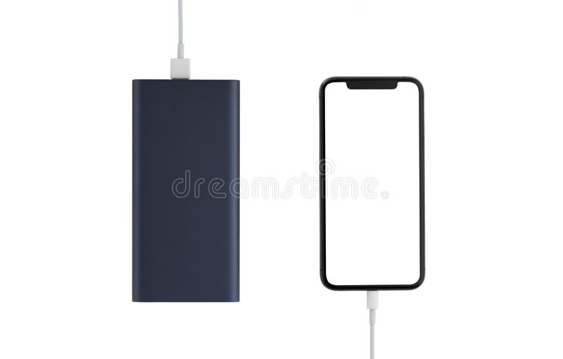 Maktbank och smartphone p? vit bakgrund royaltyfria bilder