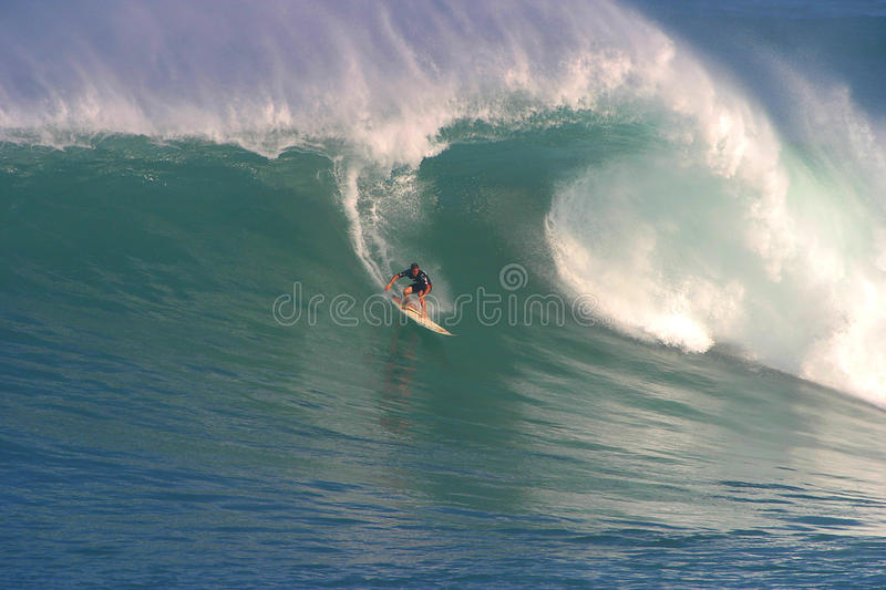 Makua Rothman Surfing at Waimea Bay. Pro surfer, Makua Rothman rides a huge wave during the Quiksilver Eddie Aikau, big wave surfing event at Waimea Bay in stock images