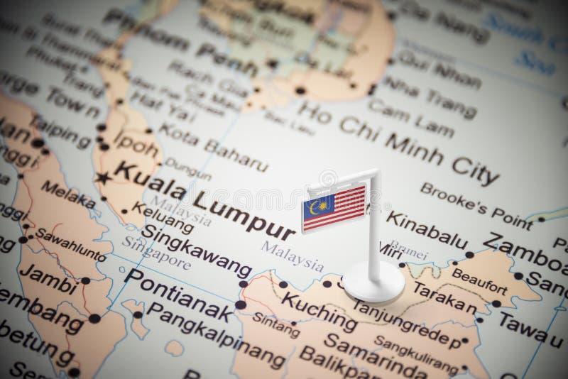 Malásia identificou por meio de uma bandeira no mapa fotografia de stock