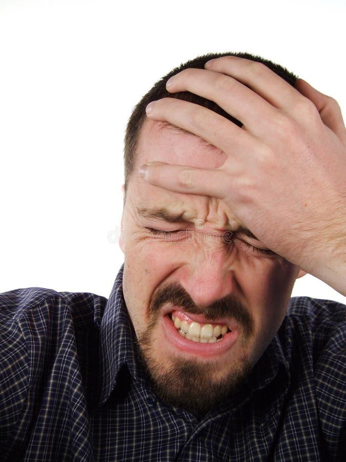 Mal de tête et souffrance - verticale mâle photo stock