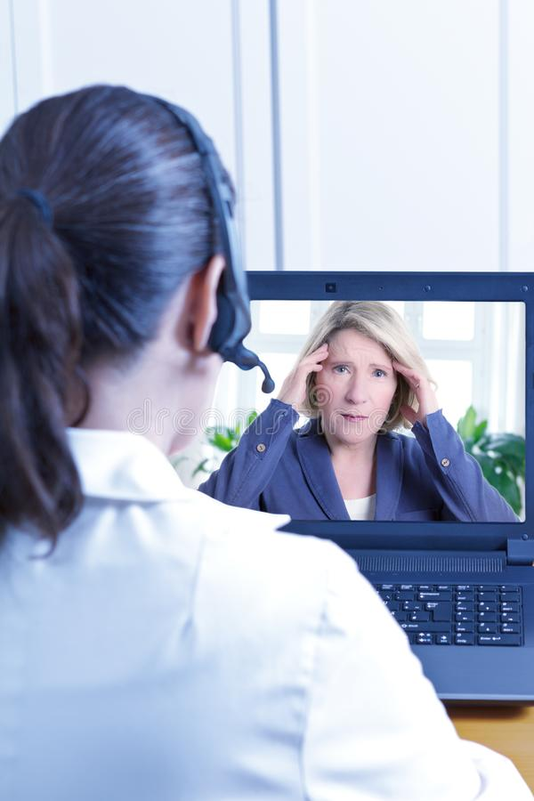 Mal de tête visuel de patient d'appel de docteur image libre de droits