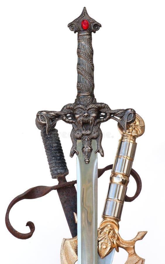 mal espantoso demoníaco cruzado de 3 espadas fotografía de archivo