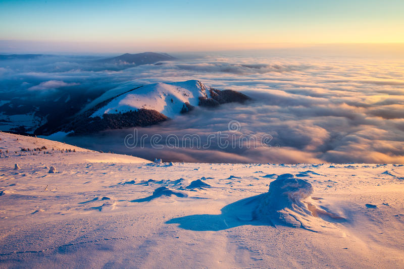 Mala Fatra sunrise inversion. Winter landscape featuring clouds inversion and a morning sunlight stock photos